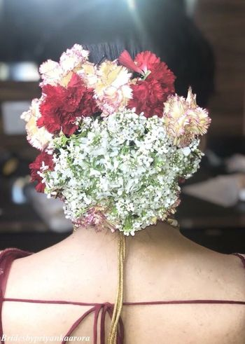 Bridal bun with babys breath and carnations