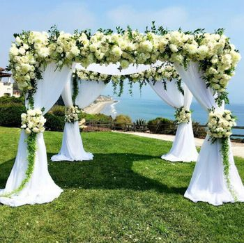 White and green floral mandap with drapes