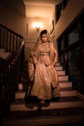 Bride in gold stepping down