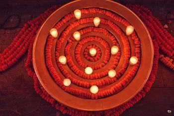 Floor arrangement with candles and genda phool
