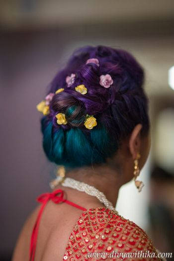 Coloured hair with small flowers in bun