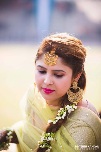 Mehendi look with side braid and gajra
