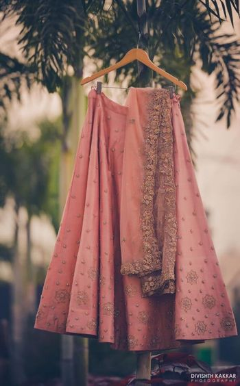 Blush pink engagement lehenga on hanger