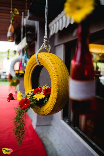 Hanging painted tyres with flowers