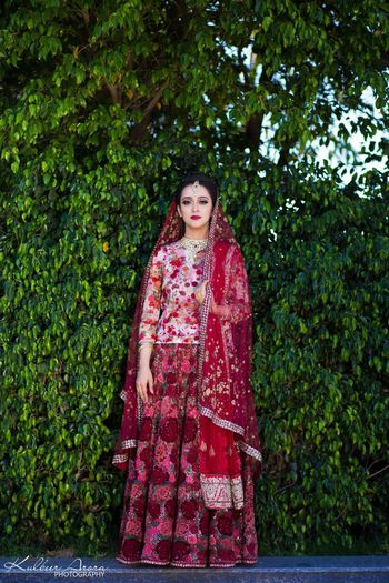 Offbeat bride in floral bridal lehenga