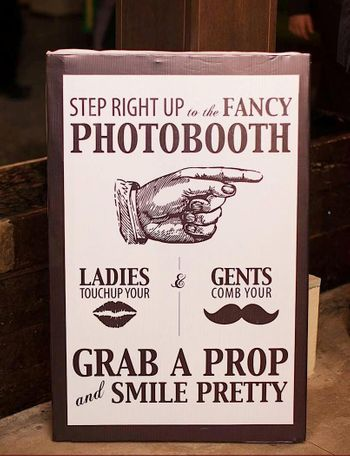 Grab a prop Photo Booth board
