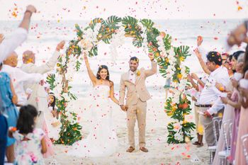 A Christian couple right after their wedding ceremony at a beach