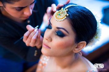 Ink blue smokey eyes makeup for bride