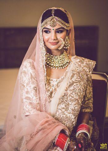 Pastel bridal lehenga look with Nath
