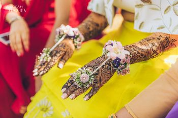 Photo of Floral and pearl hand harness for mehendi
