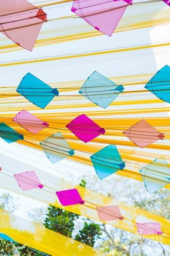 Photo of Kites with yellow drapes in mehendi decor