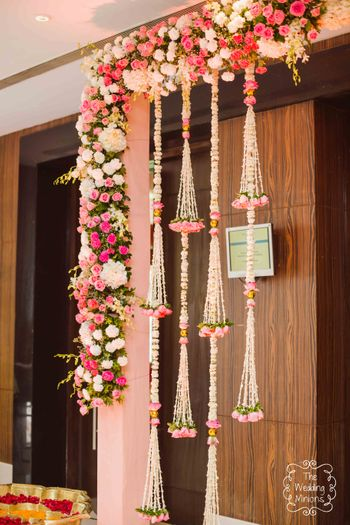 Pretty hanging floral decor in pink and white