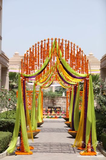 Entrance decor with hanging floral strings and colorful drapes