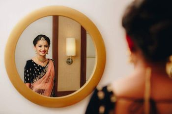 Bridal portrait with bride looking in mirror