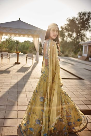 Photo of Yellow anf turquoise mehendi lehenga