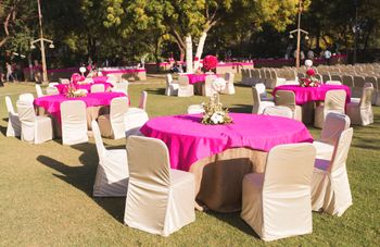 pink tables with white chairs