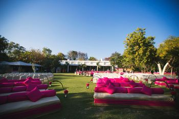 white and pink sofas with bright pink cushions