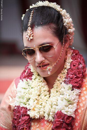 Photo of bride wearing sunglasses