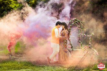 Pre wedding shoot using color bombs