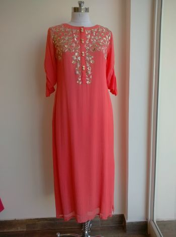 Photo of simple pink tunic with gold work