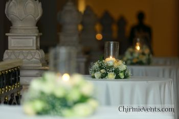 Simple floral and candle lit table centerpiece