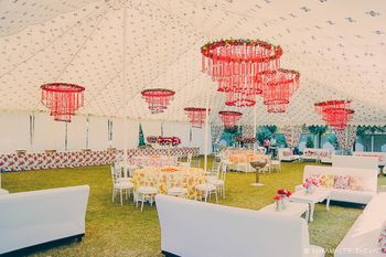Red floral chandeliers in day decor