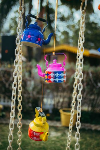 Hanging Colorful tea kettles in decor