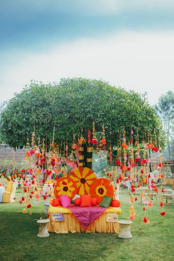 Beautiful mehendi seating for bride with colorful hanging elements