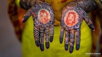 Unique portrait mehendi on brides hands