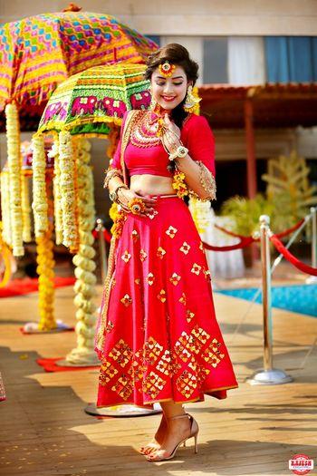 Short mehendi lehenga in red with subtle gold details