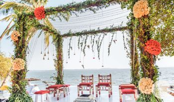 Beautiful beach side mandap done in greenery and colourful flowers