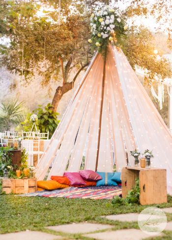 Beautiful outdoor tents with fairy lights and colourful pillows