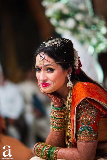 Happy south Indian bride posing