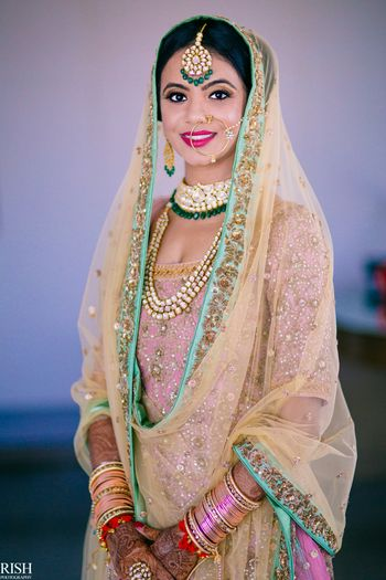 Sikh bride in pastel lehenga and contrasting jewellery