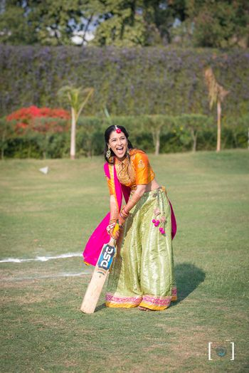 Bride playing cricket on mehendi