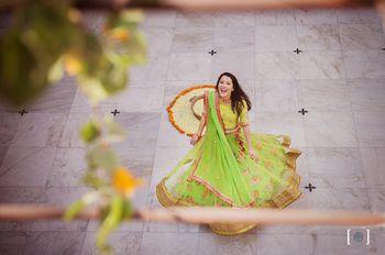 Bride twirling in pretty green lehenga