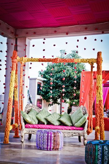 Photo of Mehendi jhoola decor with marigolds