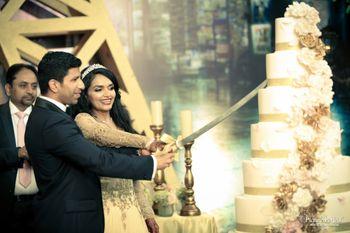 Photo of 6 tier white wedding cake