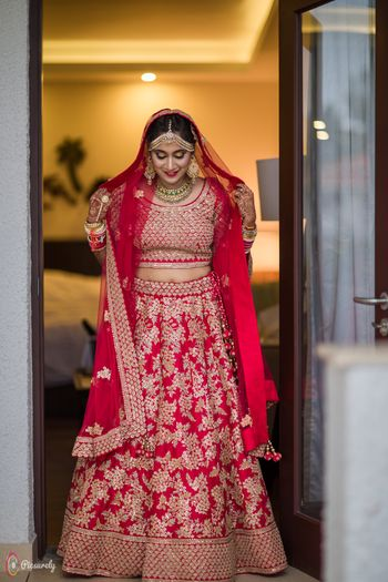 Red bridal lehenga with floral embroidery work
