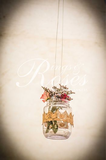 Hanging glass jars with flowers in decor