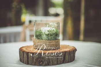 Candle inside a glass table centerpiece
