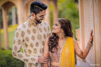 Photo of Couple portrait on mehendi gazing into each others eyes