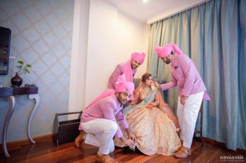 Cute bridal photo with brothers feeding her