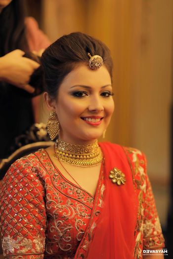 Bride wearing choker necklace and bola