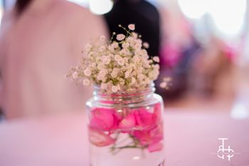 Flowers in glass jars as table centerpiece