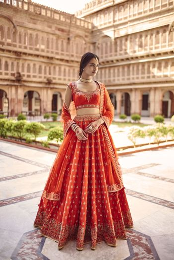 Photo of Red and orange simple bridal lehenga by Anita dongre