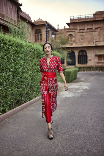 Photo of Red outfit with pants for sister of the bride