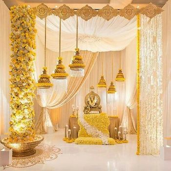 South Indian wedding decor with yellow and white florals