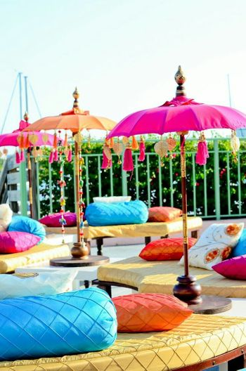 Mehendi seating idea with umbrellas with tassels