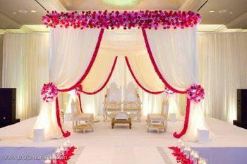 Indoor mandap decor in pink and white with drapes